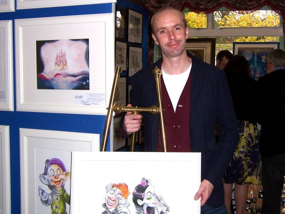 Douglas Rickard with his drawings of Walt Disney Classics Collection sculptures