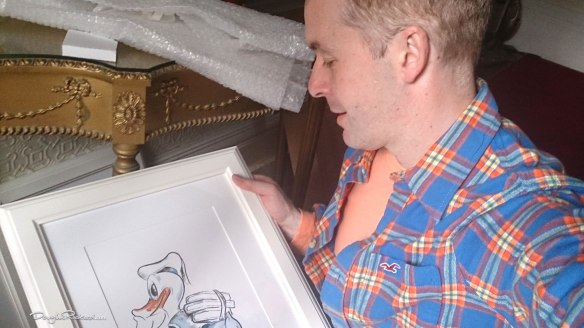 Douglas Rickard and his Donald Duck drawing of the WDCC sculpture